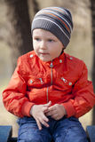 Baby boy in orange jaket and blue jeans Royalty Free Stock Photography