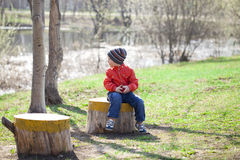 Baby boy in orange jaket and blue jeans Royalty Free Stock Photo