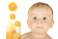 Baby boy with orange juice Royalty Free Stock Image