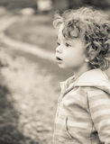 Baby boy outdoor in the countryside Stock Image