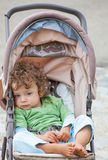 Baby boy outdoor in stroller Stock Images