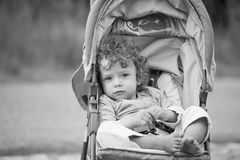 Baby boy outdoor in stroller Stock Photo