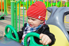 Baby boy outdoors in amusement park Stock Photos