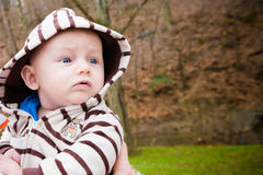 Baby Boy Outside Wearing Striped Hoodie Stock Photography