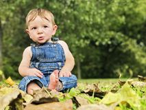 Baby boy in overalls Stock Photography