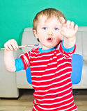 Baby boy with paintbrush. Baby boy with his paintbrush Royalty Free Stock Image
