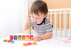 Baby boy painting at home Royalty Free Stock Photos