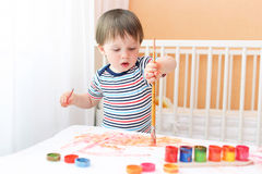 Baby boy painting at home Royalty Free Stock Photo