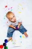 Baby boy paints Stock Photos