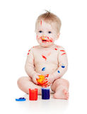 Baby boy with paints Stock Images