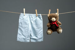 Baby boy pants, a teddy bear on the clothesline Stock Photo