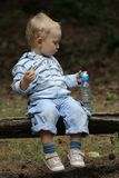 Baby boy and picnic Stock Image