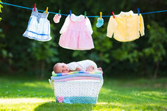 Baby boy on a pile of towels outdoors Stock Photos