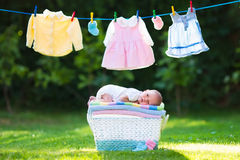 Baby boy on a pile of towels outdoors stock image
