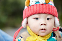 Baby boy  in pink winter knitted hat Royalty Free Stock Photos