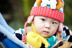 Baby boy  in pink winter knitted hat Royalty Free Stock Photography