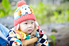 Baby boy  in pink winter knitted hat Royalty Free Stock Images
