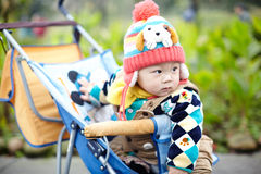 Baby boy  in pink winter knitted hat Stock Photos