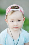 Baby boy in a plaid cap on a green background Royalty Free Stock Images
