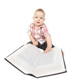 Baby boy play with book on white Stock Image
