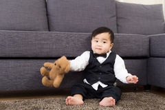 Baby boy play with doll Royalty Free Stock Photos