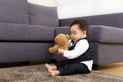 Baby boy play doll Stock Photography