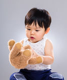 Baby boy play doll toy Royalty Free Stock Photography