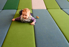 Baby boy on play mattress stock photos