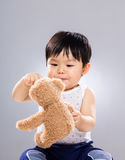 Baby boy play toy doll Stock Photos