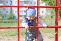 Baby boy on playground. Baby boy age of 11 months on playground Stock Photos