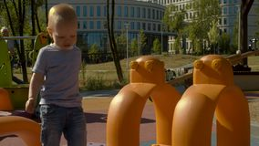 Baby boy on the playground. In the park. Slow motion stock footage