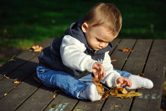 Baby boy playing Stock Images