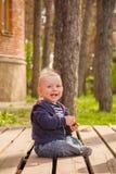 Baby boy playing in backyard Royalty Free Stock Photo