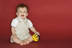 Baby boy playing with ball. stock photography