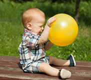 Baby boy playing with a ball Royalty Free Stock Image