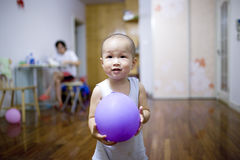 Baby boy playing balloon Royalty Free Stock Images