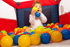 Baby boy playing with balls Royalty Free Stock Photography