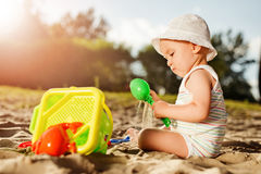 Baby boy playing with beach toys Royalty Free Stock Image