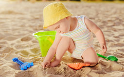 Baby boy playing with beach toys Stock Photography