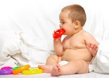 Baby boy playing in the bed Royalty Free Stock Photo