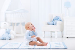 Baby boy playing in bedroom royalty free stock photos
