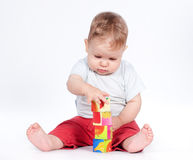 Baby boy playing with blocks on white Stock Photo