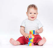 Baby boy playing with blocks on white Stock Images