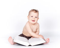 Baby boy playing with book on white Royalty Free Stock Photo