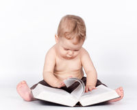 Baby boy playing with book on white Royalty Free Stock Photography