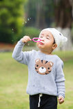 Baby boy playing bubble Stock Photos