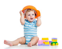 Baby boy playing with building blocks toy. Kid boy playing with building blocks toy stock photography