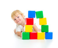Baby boy playing with building blocks Stock Photo