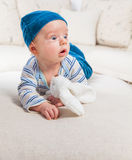 Baby boy playing with bunny Royalty Free Stock Photos