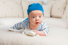 Baby boy playing with bunny Royalty Free Stock Image